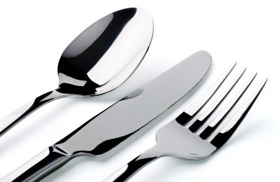 Cutlery: spoon, fork, knife closeup, isolated on a white background